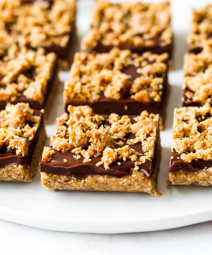straight on shot of no-bake oat fudge bars on a white plate