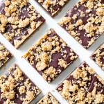 overhead close up shot of vegan oat fudge bars on a white plate