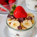 straight on angled shot of a bowl of chunky monkey overnight oats topped with a strawberry