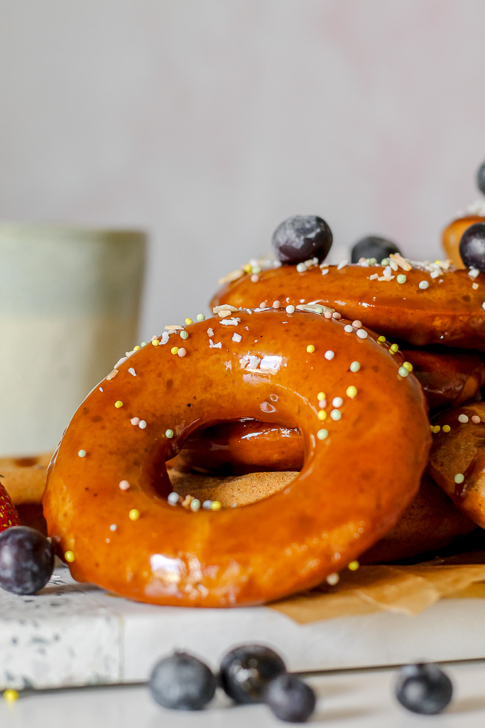 straight on shot close up of one healthy banana doughnut with caramel glaze