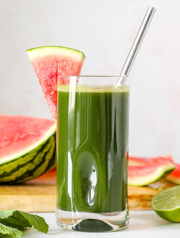 straight on shot of a glass of the watermelon lime mint kale green juice