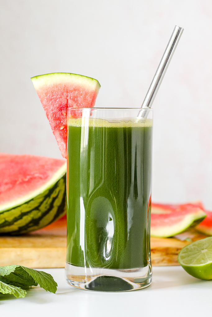 straight on photo of a glass of the watermelon lime green juice on a white table