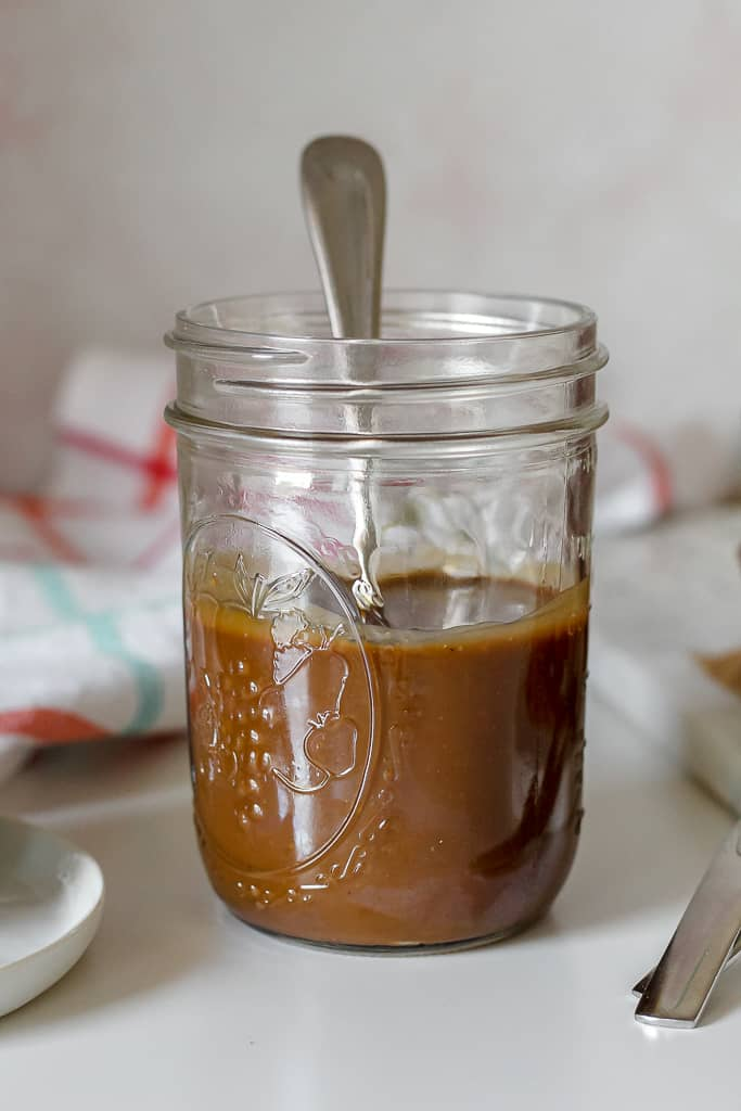 straight on shot of a jar of coconut caramel sauce
