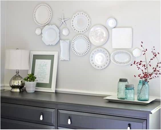 white plates on a wall