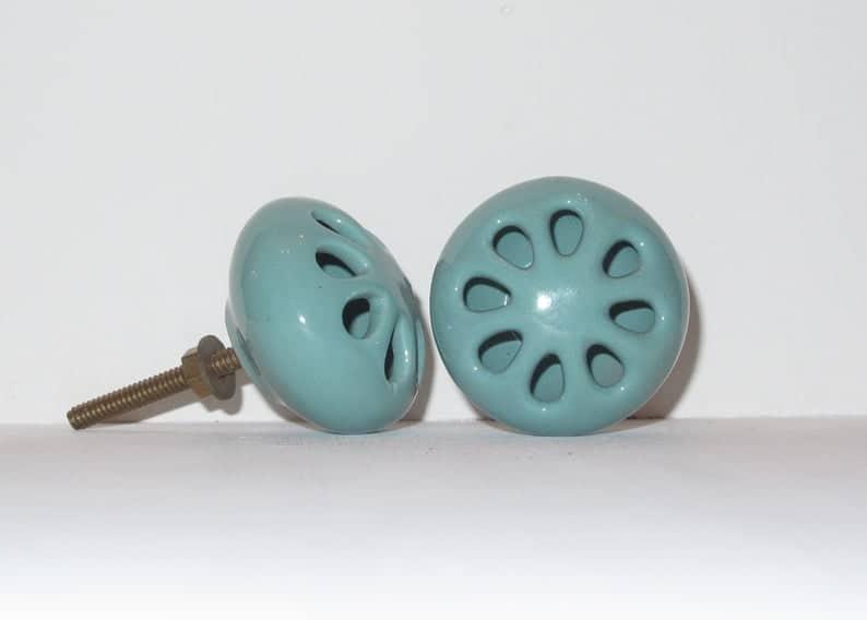 hollow teal ceramic knobs