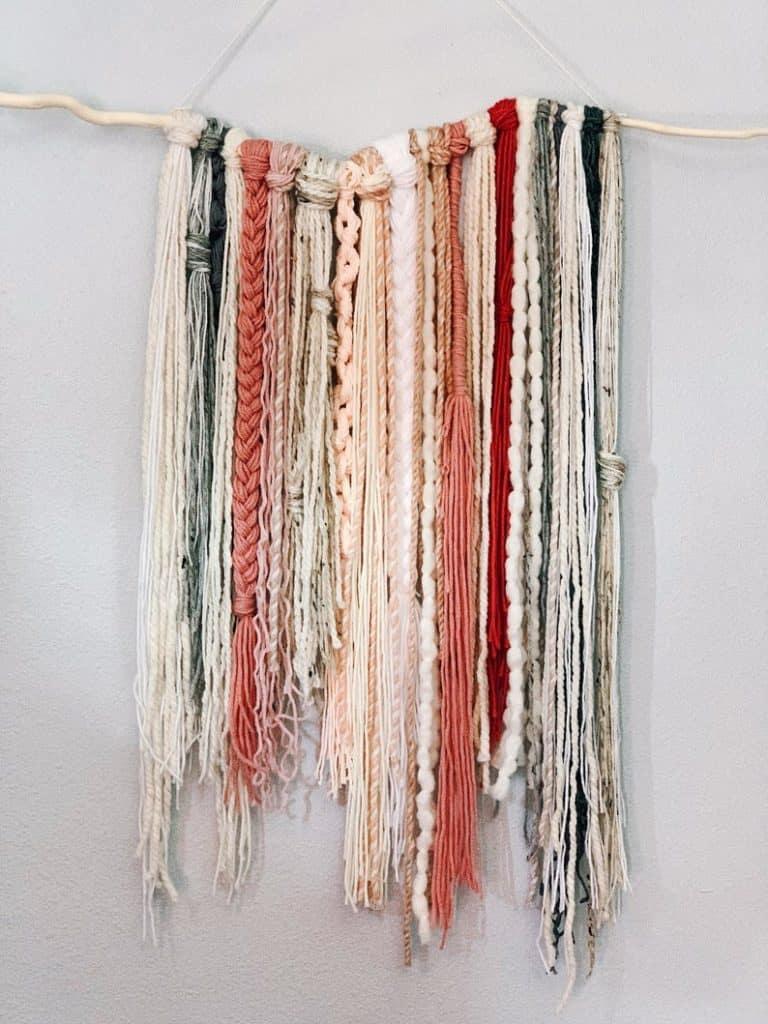 yarn and beads wall hanging