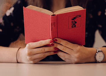 Woman reading red book