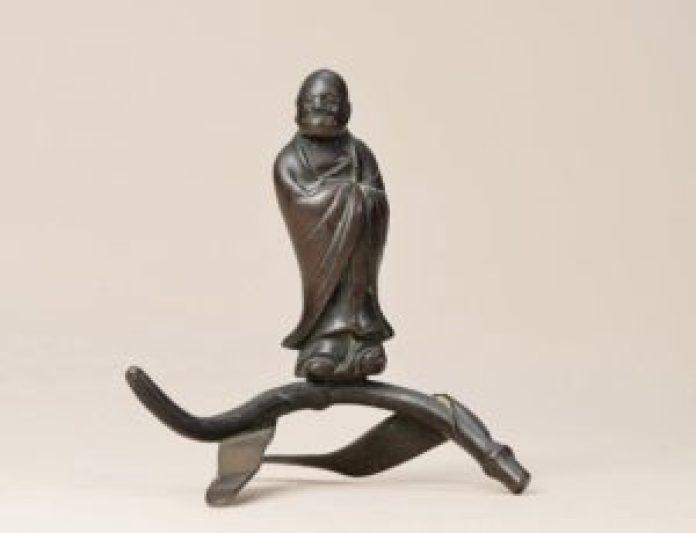 达摩双脚踏于芦苇之上,飘飘然渡过了长江(清 一苇渡江笔架 北京保利)