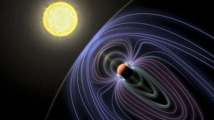艺术家对系外行星Tau Boötes b的描述显示了一个磁场,这可能导致科学家认为他们已经检测到的无线电发射(aotkoeln /ins)