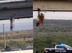 Mayat-mayat musuh digantung bawah jambatan.