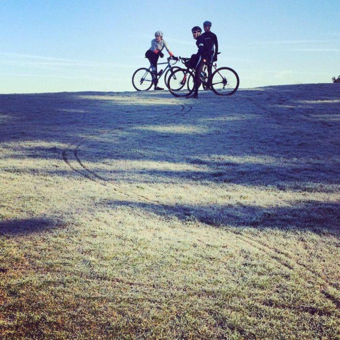 Three bikers on a path.