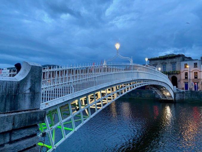 The Ha'penny Bridge in the evening with bridge lights.