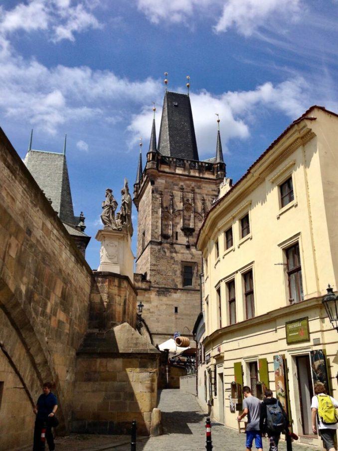 Prague street with tourist walking.