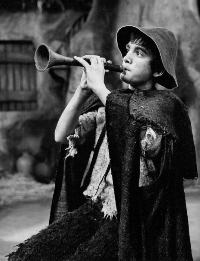 Amahl plays his flute