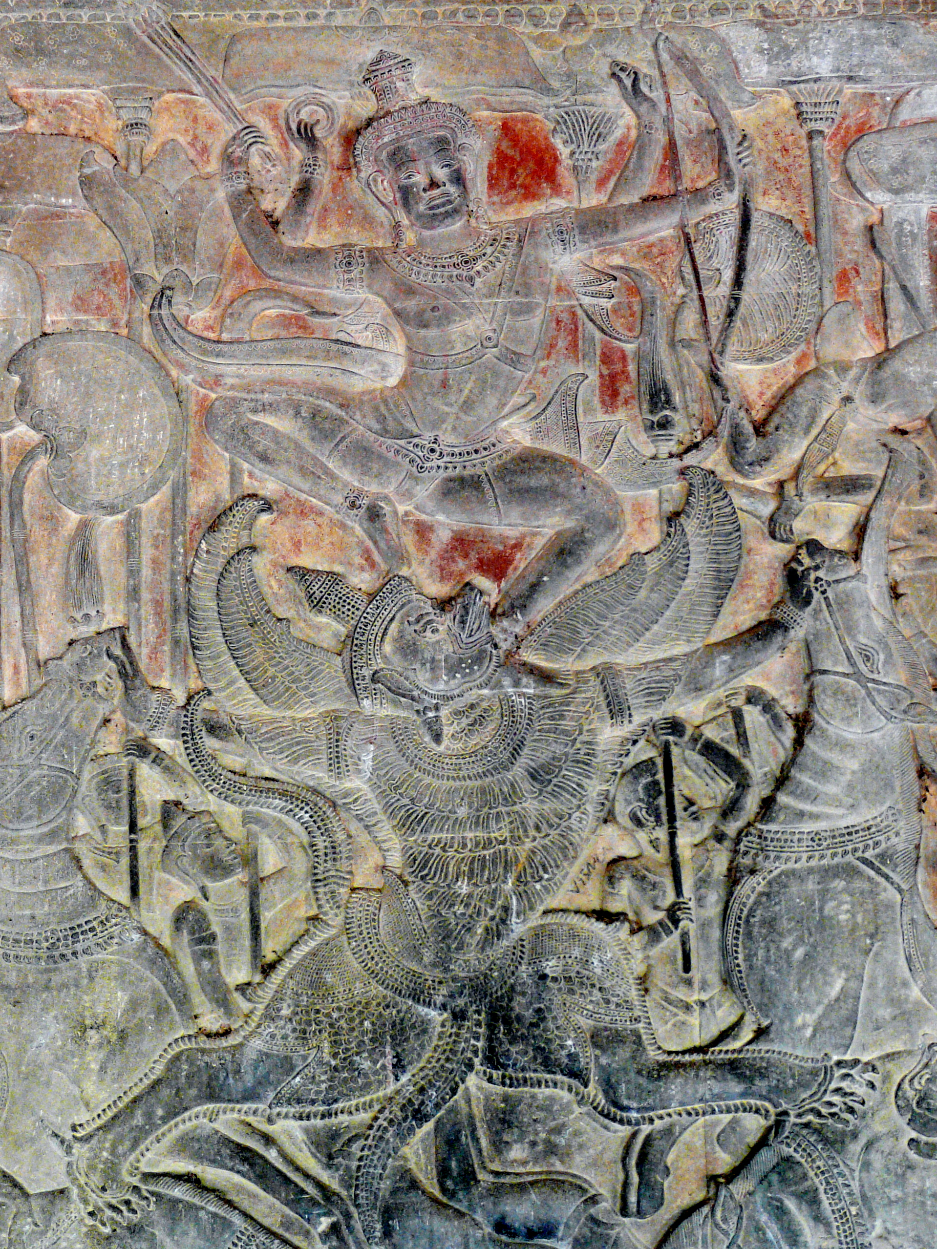 Garud, the devourer of serpents, helps Lord Vishnu defeat demons