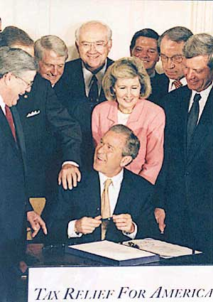 President George W. Bush signing the Economic ...