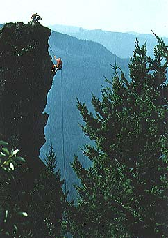 English: Climber repelling Rooster Rock in the...