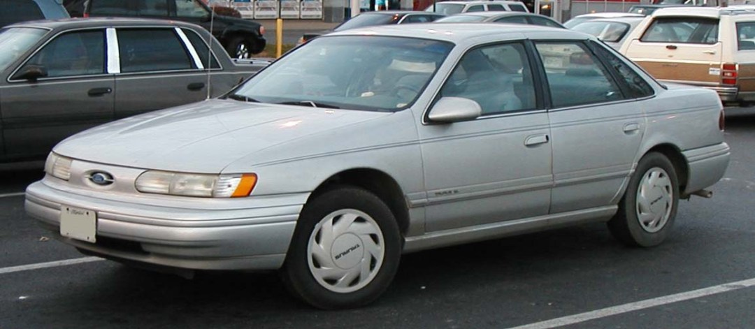 A 90s silver Ford Taurus