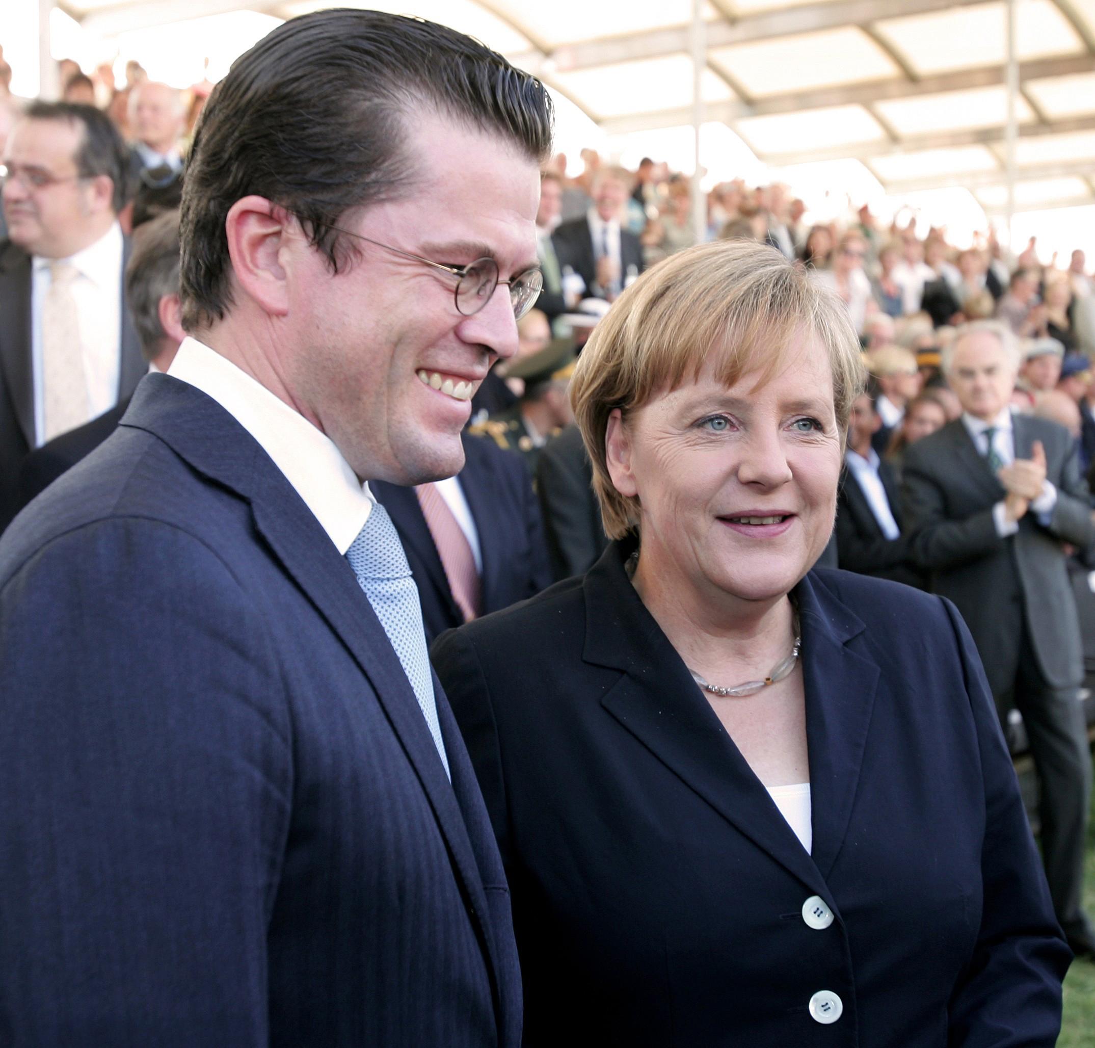 Merkel, zu Guttenberg