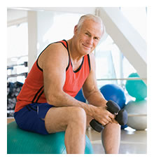 English: Elderly man with a dumbell sitting on...