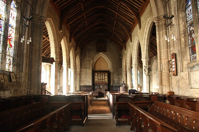 All Saints' nave Looking west from the chancel with early Perpendicular arcades c1420.