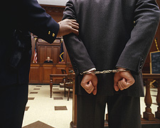 Cuffed Defendant before criminal court (Transp...
