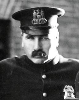 Tom Wilson as the cop in The Kid (1921)