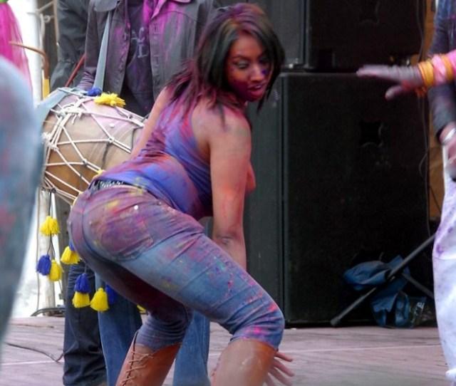 A Woman Twerking At A Music Festival