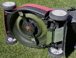 A rotary mower (viewed from underneath), with ...
