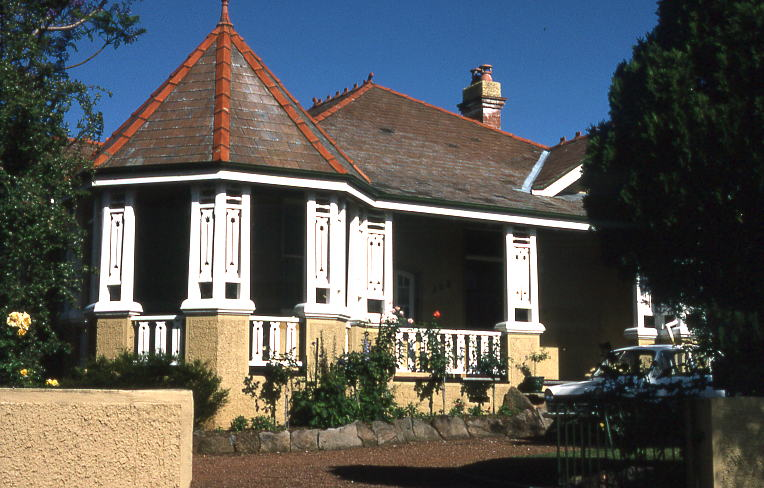Gothic styled 'Olmora' 308 Burwood Rd, Queen Anne Federation home, Burwood, Sydney with characteristic white painted woodwork, finial on turret, terracotta ridge ornaments