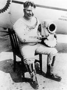 Wiley Post, first to fly solo around the world, in an early pressure suit for high-altitude flying - Wikimedia photo
