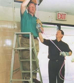 President Bill Clinton installing computer cab...