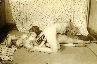 a trio of languid lesbians enjoying a salami.