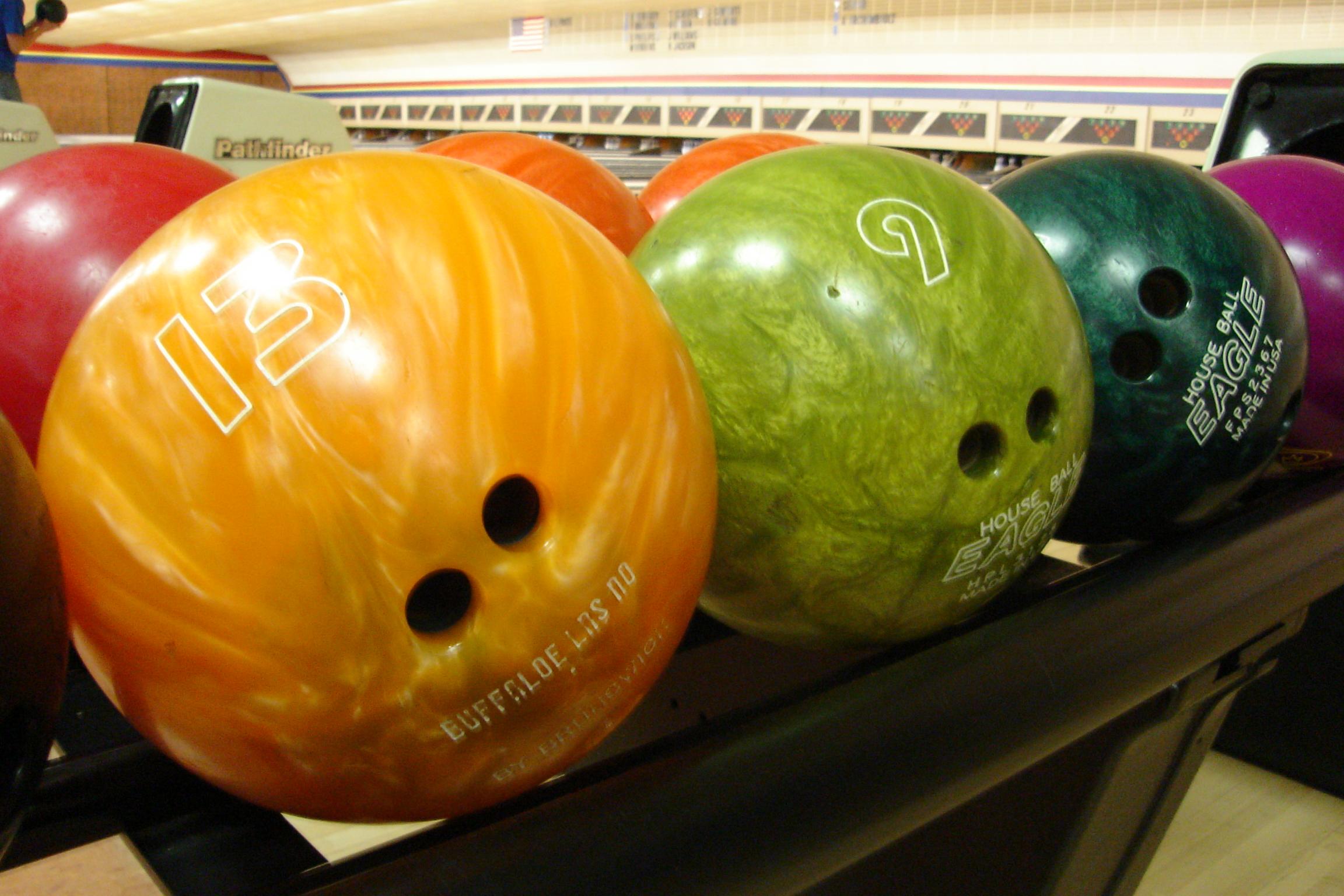 Bowling balls at a bowling ally