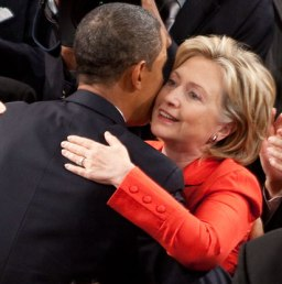 Barack Obama and Hillary Clinton hugging inside the House Chamber of the US Capitol in 2009 (cropped)