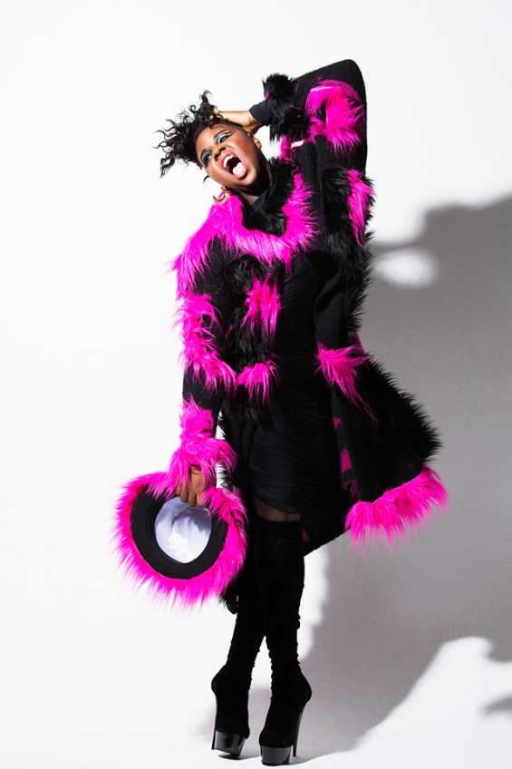 Alex Newell wearing pink and black coat, might be in Secret Celebrity Drag Race
