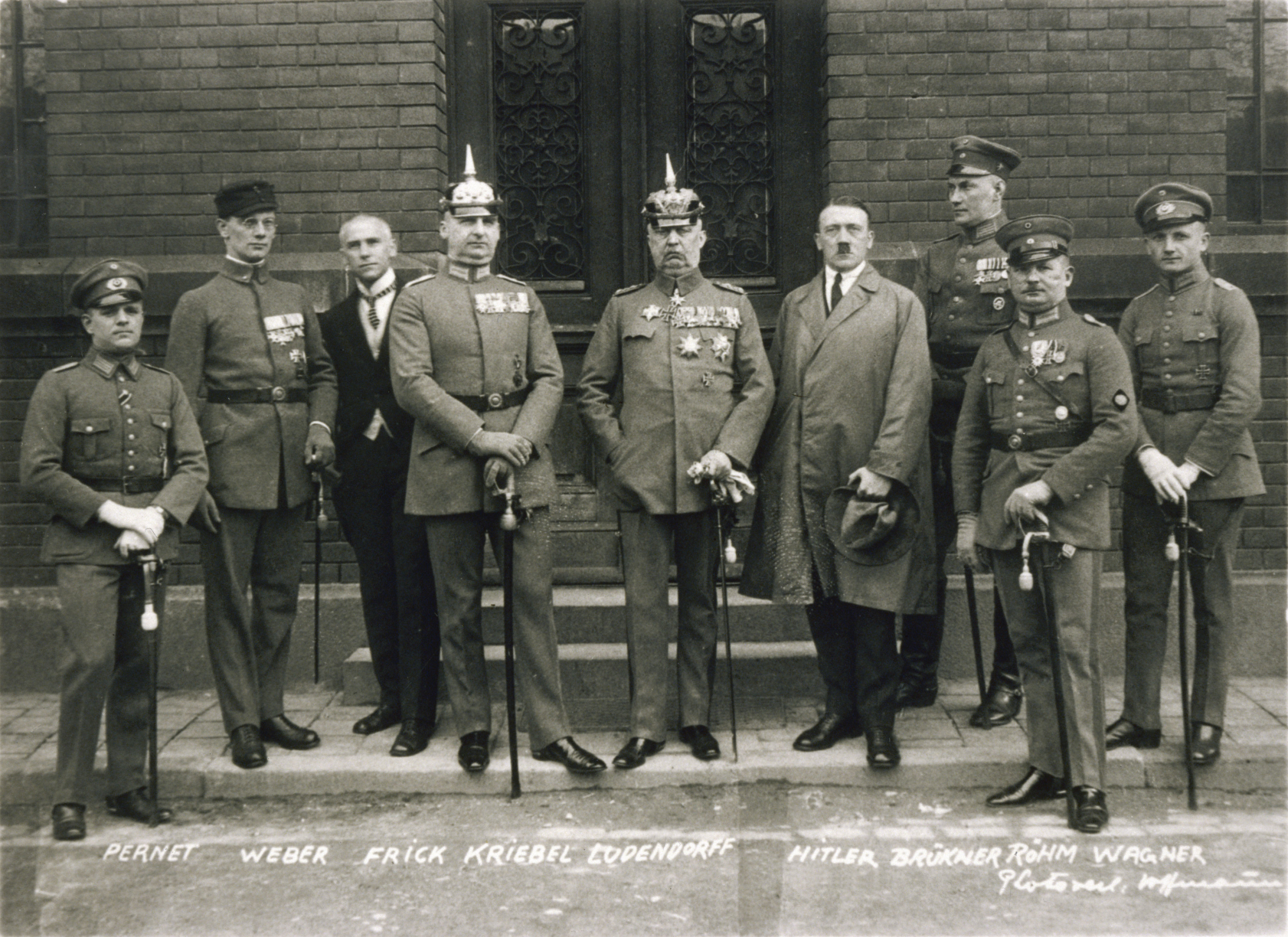 Defendants in the Beer Hall Putsch trial. From left to right: Pernet, Weber, Frick, Kiebel, Ludendorff, Hitler, Bruckner, Röhm, and Wagner. Note that only two of the defendants (Hitler and Frick) were dressed in civilian clothing.