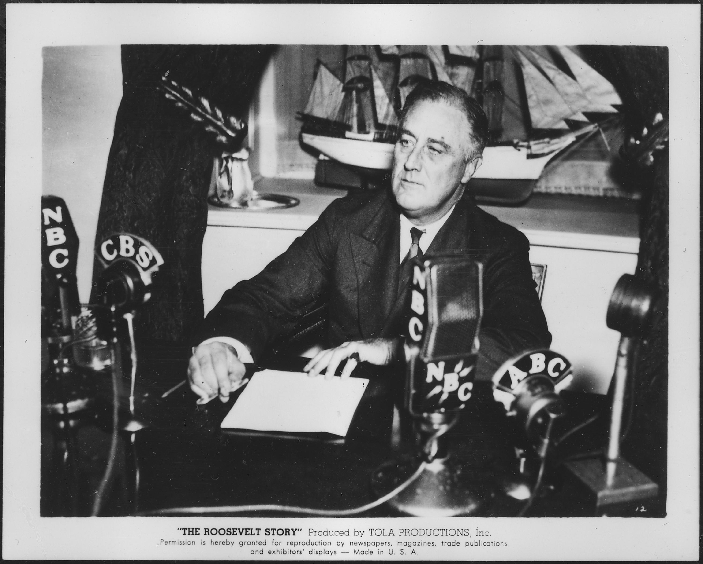 Franklin D. Roosevelt having a fireside chat i...