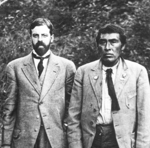 Alfred L. Kroeber with Ishi in 1911. Ishi is b...