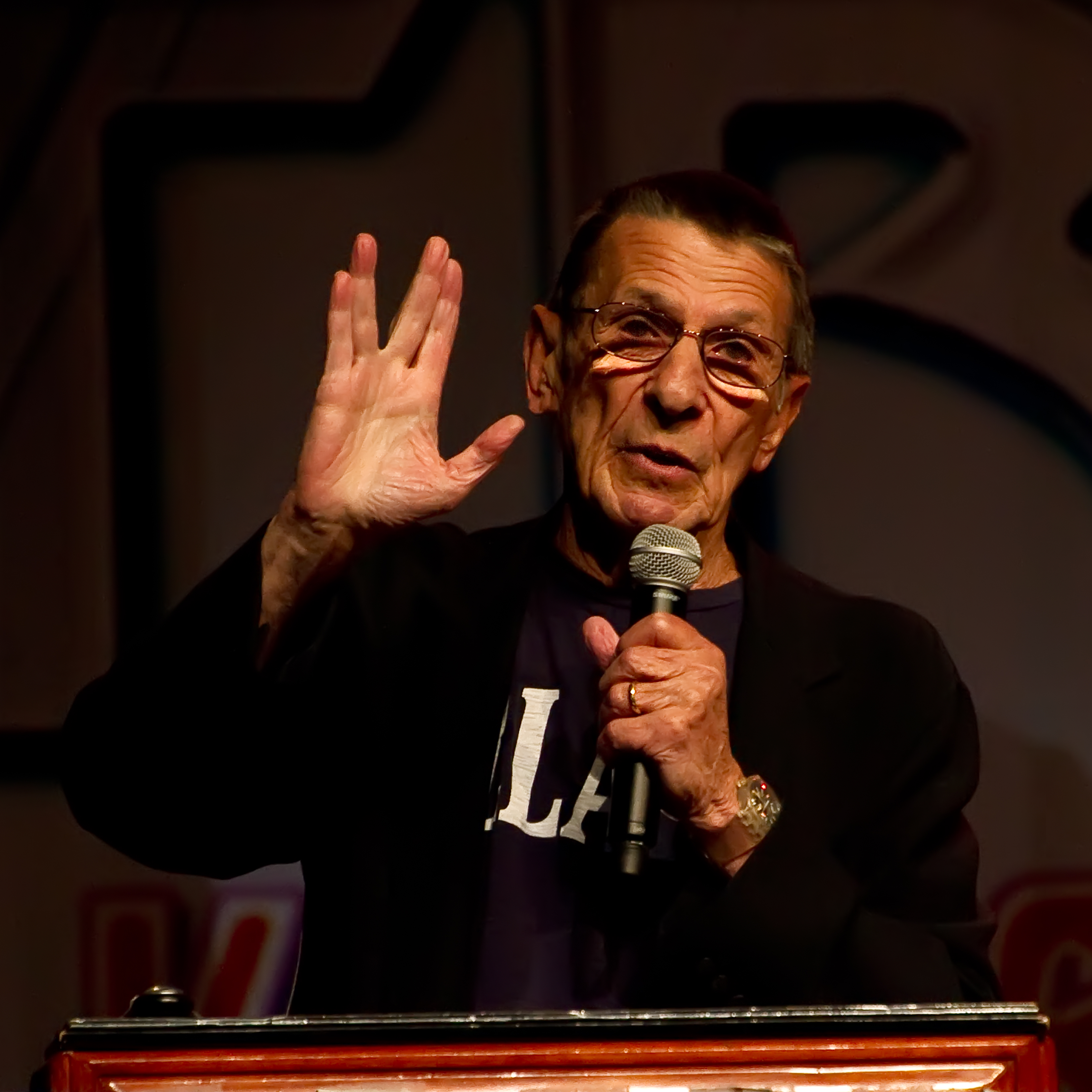 Leonard Nimoy giving a the Vulcan hand-sign for
