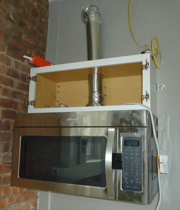 https commons wikimedia org wiki file kitchen renovation 9a cabinet and microwave with exhaust duct pipe jpg