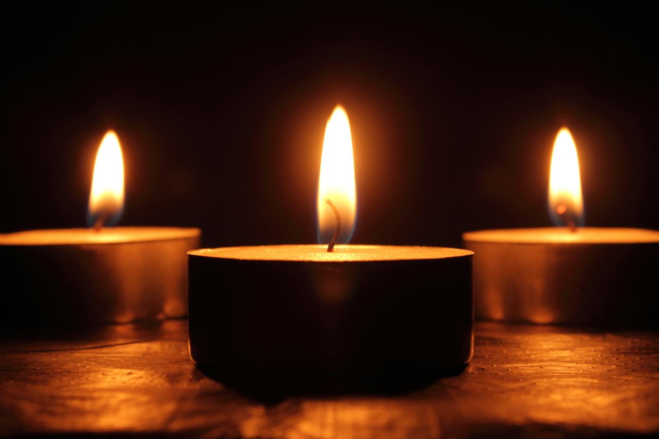 A triptic of tea light candles.