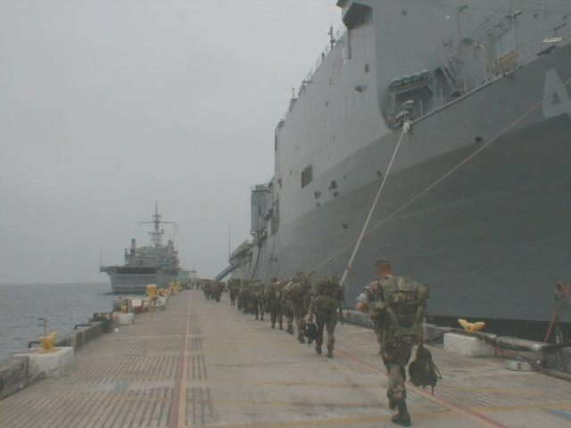 English: Marines embarking onto amphibious ass...