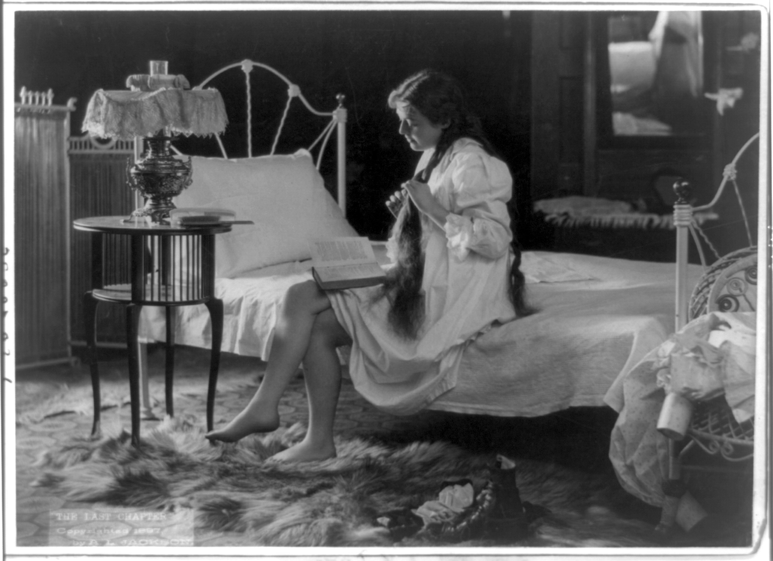 Young woman, with long hair, wearing nightgown...