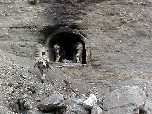 During a Sensitive Site Exploitation (SSE) mission, U.S. Navy SEALs (SEa, Air, Land) explore the entrance to one of 70 caves they discovered in Zhawar Kili area. Used by Al Qaeda and Taliban forces, the caves and other above-ground complexes were subsequently destroyed either by Navy Explosive Ordnance Disposal (EOD) personnel or through air strikes called in by the SEALs. Navy special operations forces are conducting missions in Afghanistan in support of Operation Enduring Freedom.