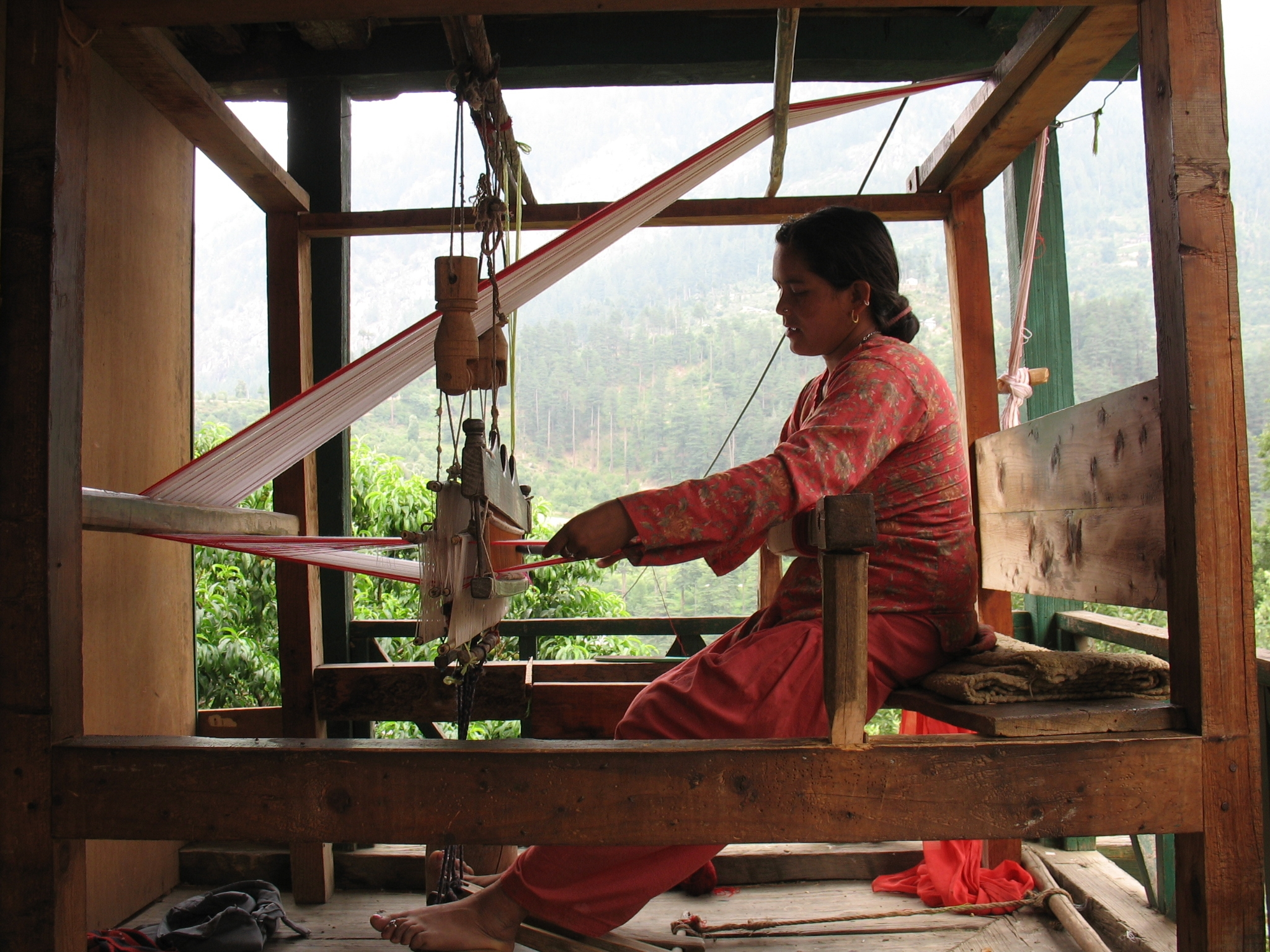 A woman weaves in India