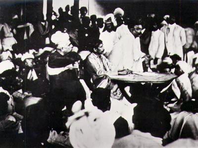 English: Sri Aurobindo presiding over a meetin...