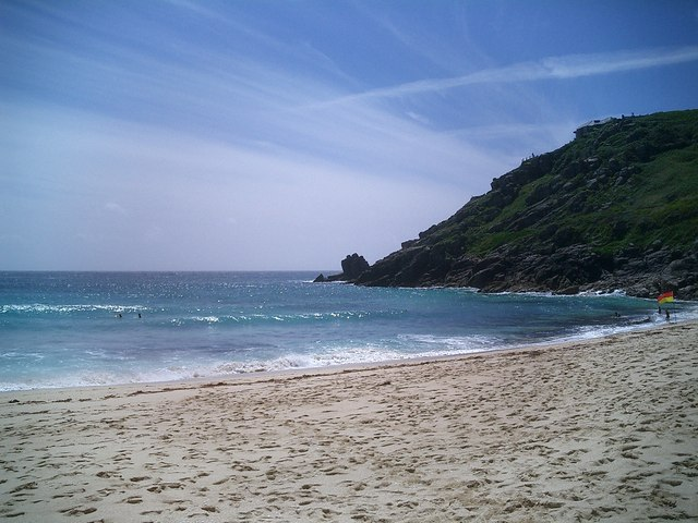 English: Porthcurno Beach A rare nice day in J...