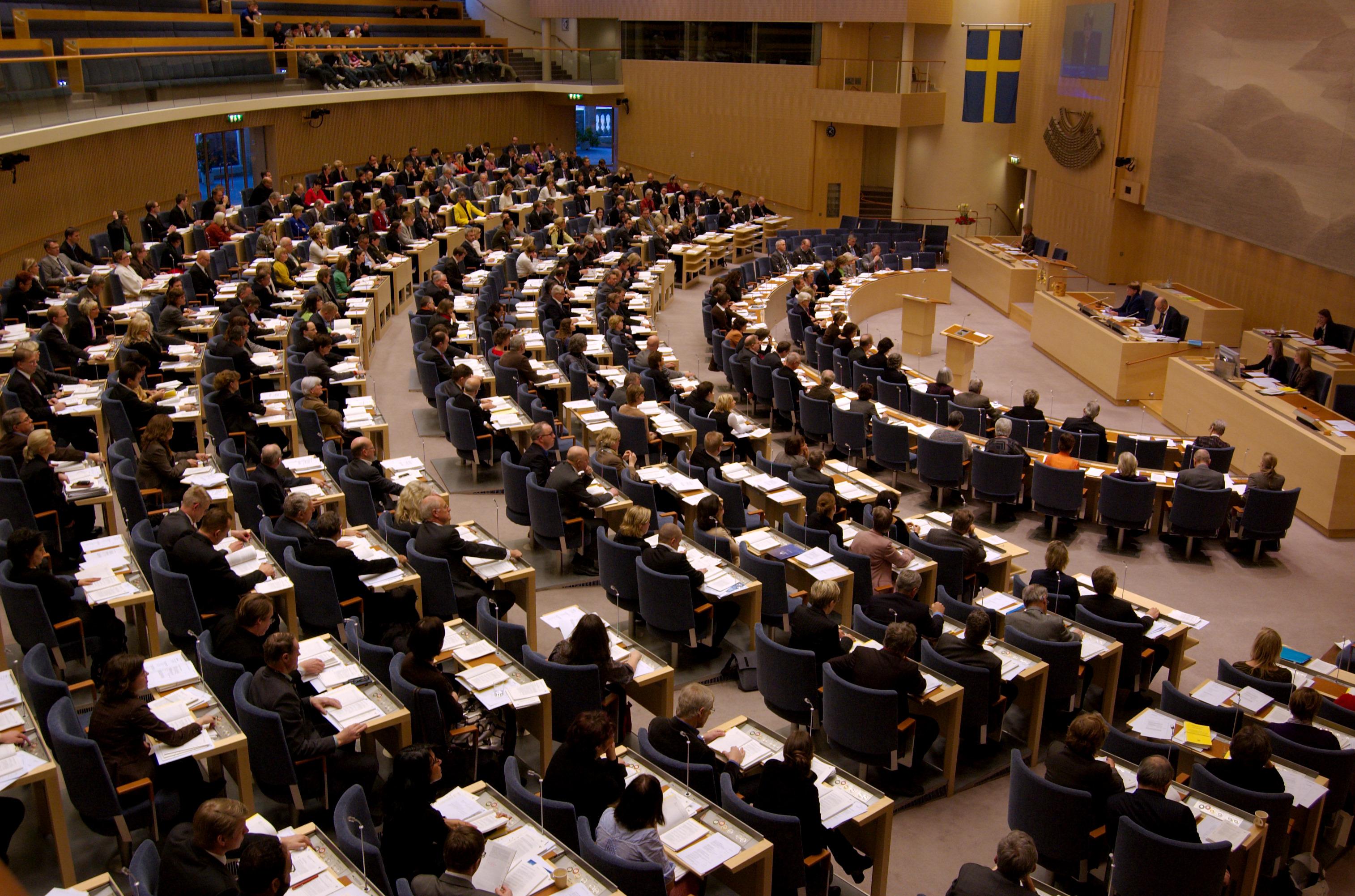 Riksdagen, som bär ansvaret för Sveriges migrationspolitik. Foto: Janwikifoto (http://politik.in2pic.com), CC-BY-SA 3.0.