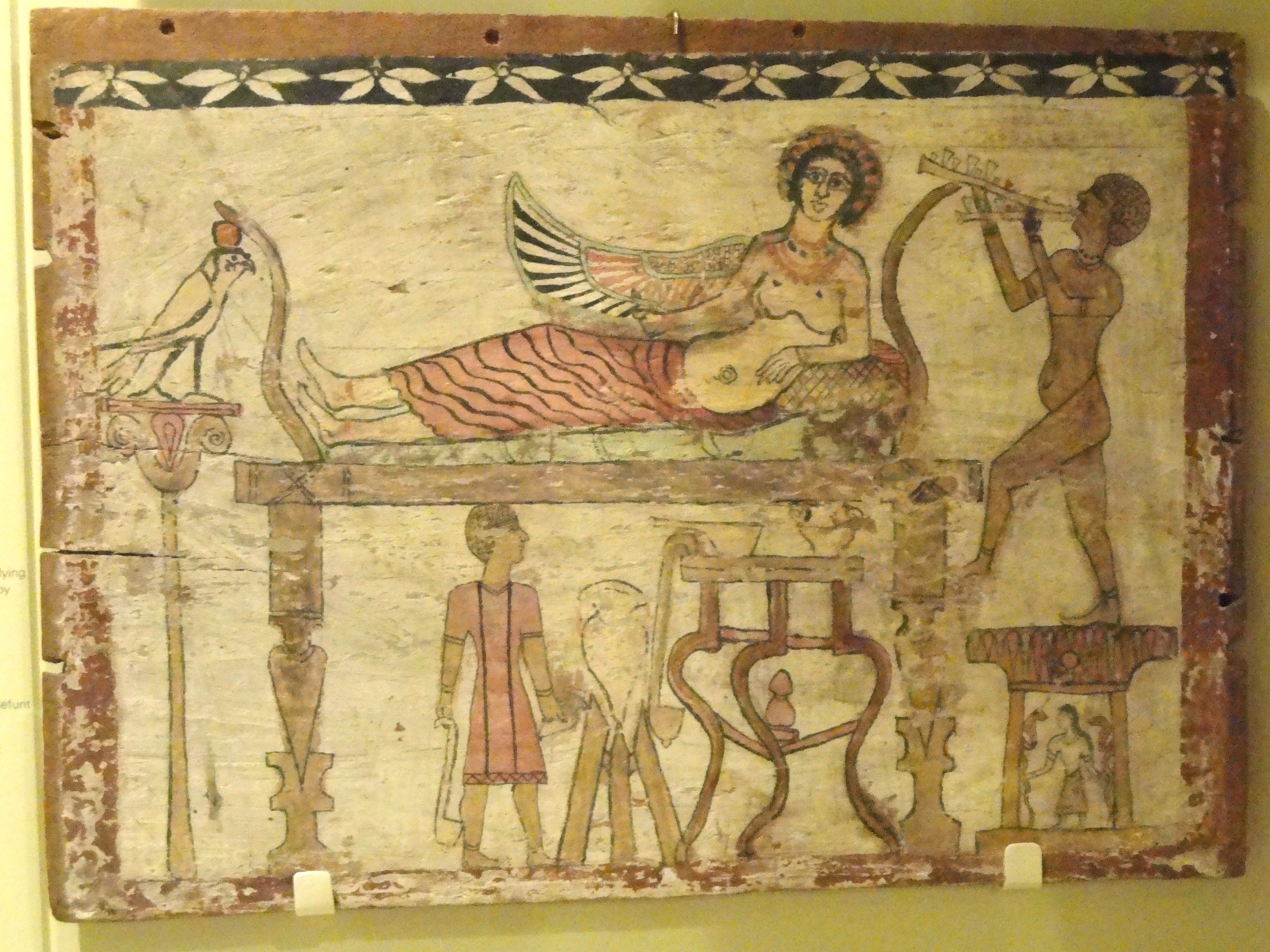 https://i2.wp.com/upload.wikimedia.org/wikipedia/commons/7/76/Coffin_floorboard_depicting_Isis_being_served_wine_by_the_deceased%2C_Egypt%2C_Roman_Period%2C_30_BC_-_AD_324_-_Royal_Ontario_Museum_-_DSC09735.JPG